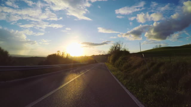 pov driving a car in tuscany, italy - country road stock videos & royalty-free footage
