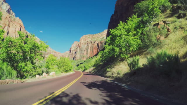 pov driving a car in zion national park - zion national park stock videos & royalty-free footage