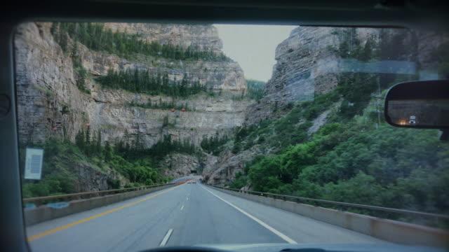 pov driving a car in zion national park - parabrezza video stock e b–roll