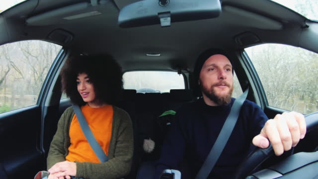 driving a car: man and woman inside view - seat belt stock videos & royalty-free footage