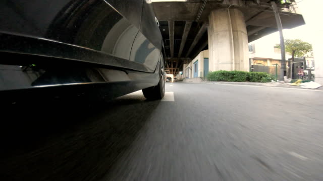 driving a car on a city - pov - point of view front. - videocamera indossabile video stock e b–roll