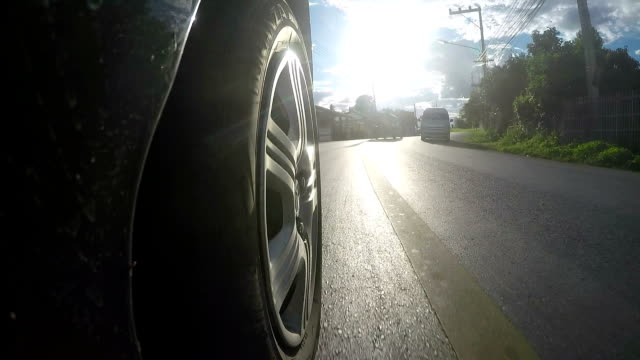 driving a car on country road - tyre stock videos & royalty-free footage