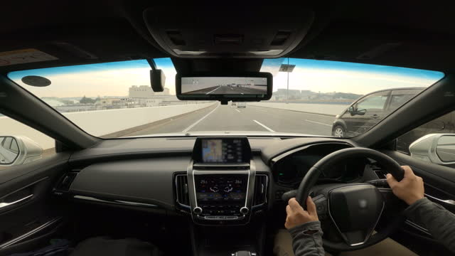 driving a car on highway. vehicle pov drives through the city highway - plusphoto stock videos & royalty-free footage
