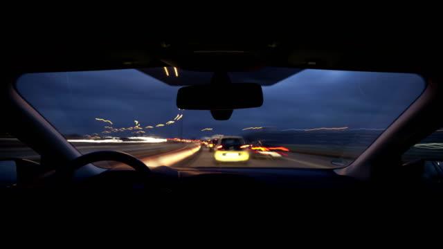 pov t/l driving a car on motorway at dusk - 光跡点の映像素材/bロール