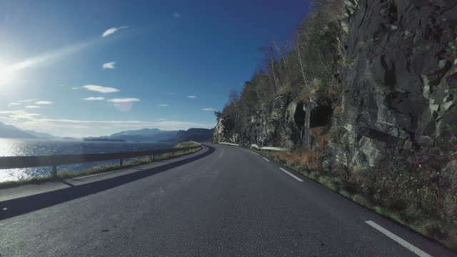 driving a car on mountain road in norway pov - coastline stock videos & royalty-free footage
