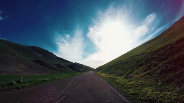 Driving a car on mountain road pass POV