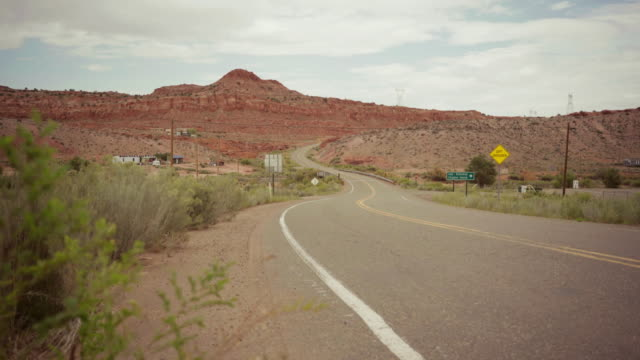 Driving a car on winding desert highway