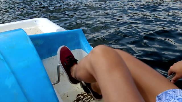 Driving a pedal boat,b roll,human legs