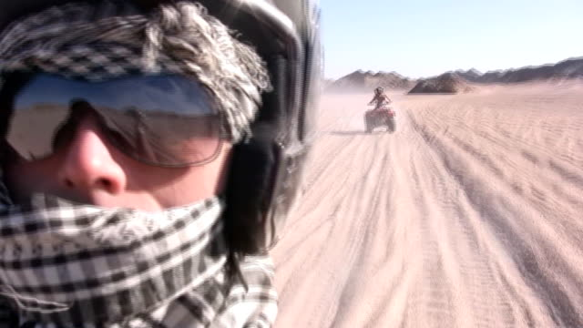 driving a quadbike at the desert - quadbike stock videos & royalty-free footage