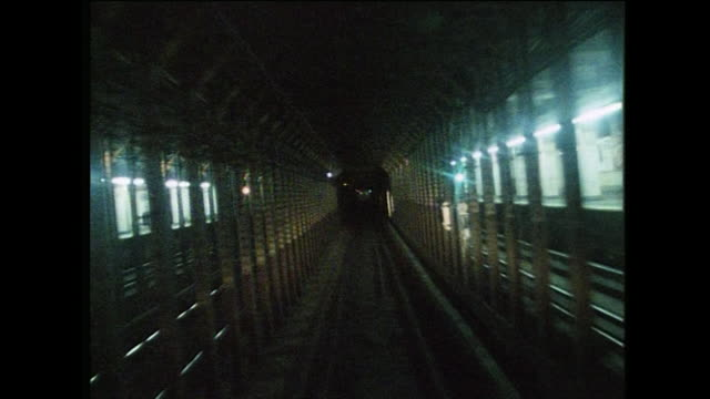 pov driving a subway train in new york; 1984 - 以前の点の映像素材/bロール