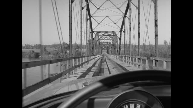 1962 pov driving across a bridge - steering wheel stock videos & royalty-free footage