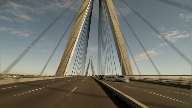 ws pov driving across modern cable-stayed anzac bridge / sydney, new south wales, australia  - brücke stock-videos und b-roll-filmmaterial