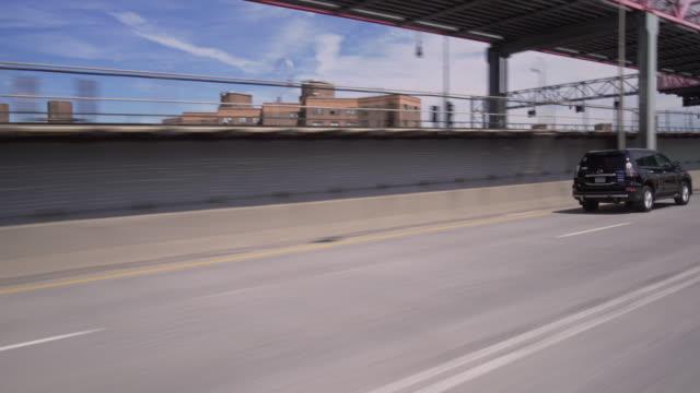 Driving across Williamsburg Bridge in New York City.