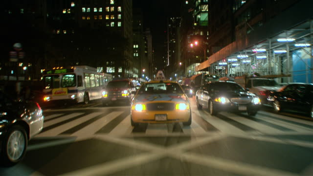 ts / rear view 90' driving along 5th avenue in new york city / new york - b roll stock videos & royalty-free footage