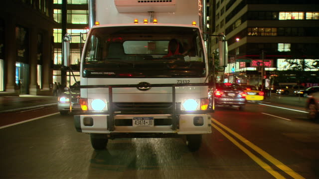 ts / rear view 90' driving along 5th avenue in new york city / new york - medium group of objects stock videos & royalty-free footage
