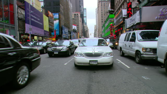 TS / REAR VIEW 90' Driving along 6th Avenue in New York City / New York