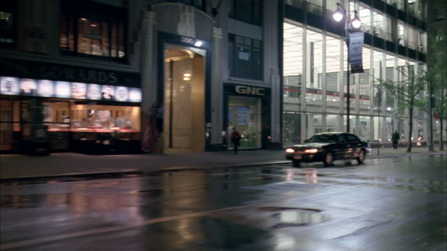 vidéos et rushes de side pov driving along a city street on rainy night / new york city, new york, united states - dolly shot