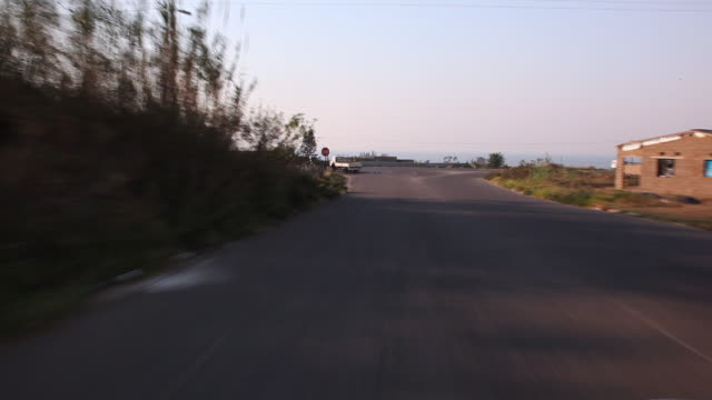 driving along a road to a stop street - stop sign stock videos & royalty-free footage