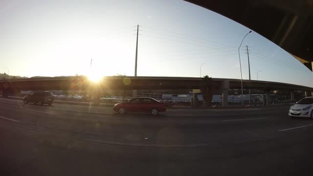 Driving along California highway, sunset