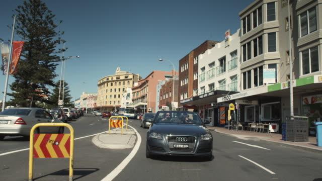 SLO MO REAR POV Driving along Campbell Parade in Bondi Beach / Sydney, Australia