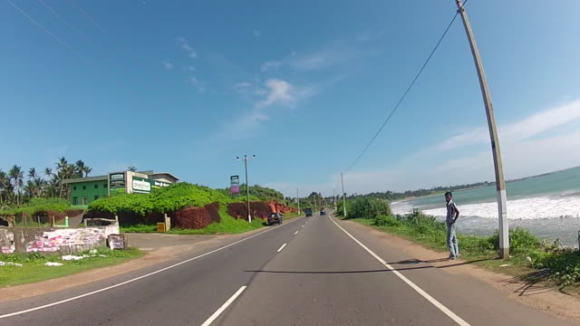 pov of driving along coastal road - road trip stock videos & royalty-free footage