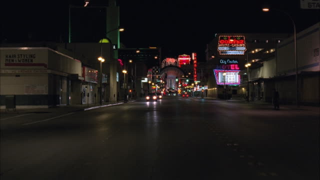 ws rear pov driving along commercial street with casinos, hotels, small stores illuminated at night / las vegas, nevada, usa - bewegliches hintergrundbild stock-videos und b-roll-filmmaterial