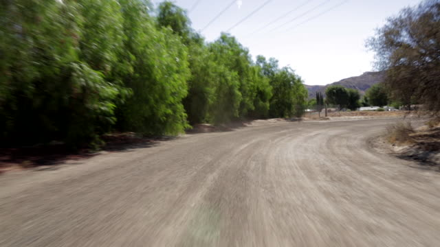 pov driving along dirt road /santa, clarita, california, united states - santa clarita点の映像素材/bロール