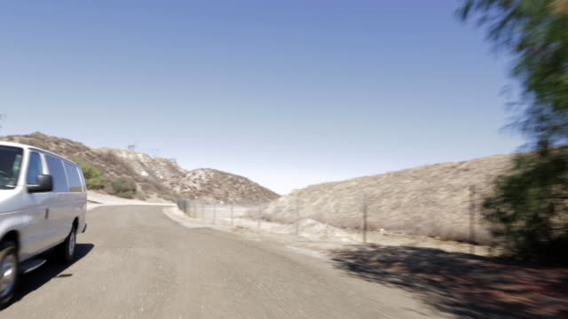 pov driving along dirt road / santa clarita, california, united states - santa clarita stock videos & royalty-free footage