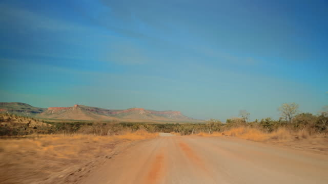 pov driving along dust track in australian outback - remote location stock videos & royalty-free footage