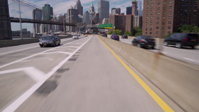 Driving along FDR drive away from downtown Manhattan and the Brooklyn Bridge.