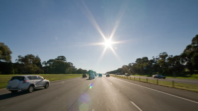 pov of driving along freeway, sun blazing above - victoria australia stock videos & royalty-free footage