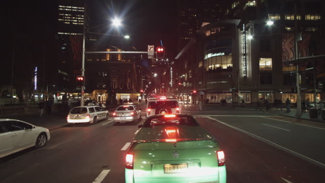 ws pov t/l driving along george street at night / sydney, new south wales, australia - sydney stock videos & royalty-free footage