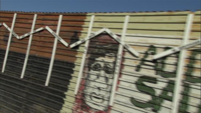 side pov driving along mexican border metal fence with graffiti / tijuana, baja california, mexico - tijuana stock videos & royalty-free footage