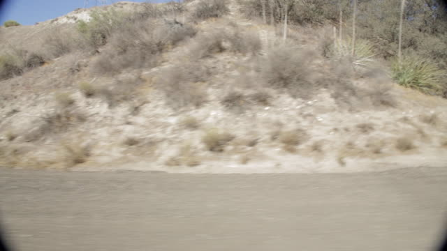 pov driving along mountainside road / santa clarita, california, united states - santa clarita点の映像素材/bロール
