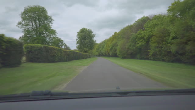 Driving along open country lane