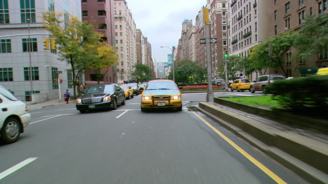 ts / rear view 90' driving along park avenue in new york city / new york - moving process plate stock videos and b-roll footage