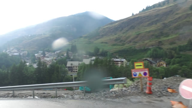 pov driving along rainy on a road under construction - downhill skiing stock videos & royalty-free footage