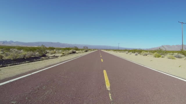 Driving along road through desert, Barstow, California, USA