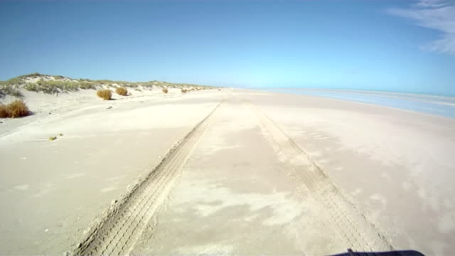hd: driving along the beach - tire track stock videos & royalty-free footage