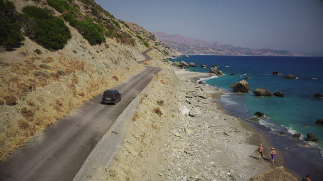 driving along the coast near triopetra - greece stock videos & royalty-free footage