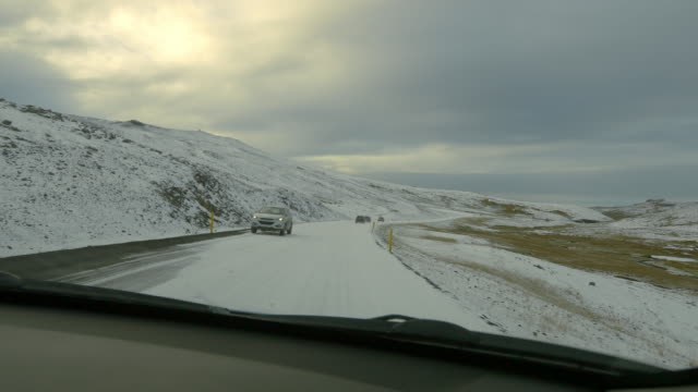 POV Driving along the mountains in Iceland