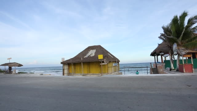 driving along the southern coastline of cozumel where palapas beach huts and the ocean can be seen - palapa stock videos & royalty-free footage