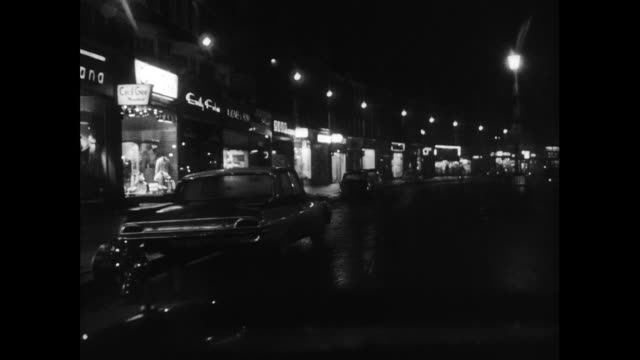 driving pov along urban london road at night; 1963 - nightlife stock videos & royalty-free footage