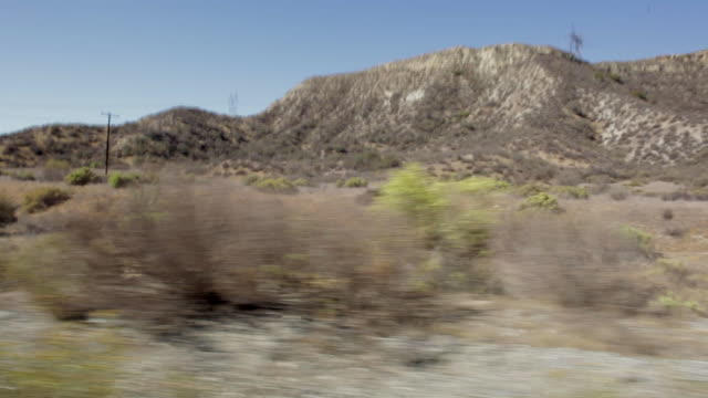 pov driving alongside mountain scenery / santa clarita, california, united states - santa clarita stock videos & royalty-free footage