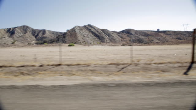 pov driving alongside rocky mountains / santa clarita, california, united states - santa clarita stock videos & royalty-free footage