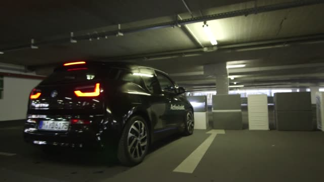 Driving an automated car in a parking garage in Munich Germany on March 20th 2015 Shots Interior wide shot of a black automated car driving off Wide...