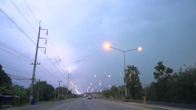 driving and lightning super slow motion - power line stock videos & royalty-free footage