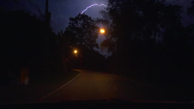 driving and lightning super slow motion - dark stock-videos und b-roll-filmmaterial