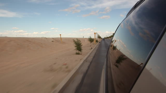 POV driving and looking out the window at the desert along the freeway/ Ciudad Juárez/ Mexico