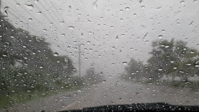 driving and rain drops on windshield. - windscreen stock videos & royalty-free footage